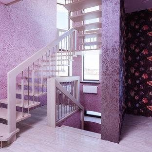 Ejemplo de escalera suspendida, contemporánea, de tamaño medio, con escalones de madera
