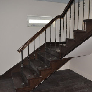 Example of a large transitional painted wood railing staircase design in Moscow with painted risers