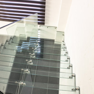 Inspiration for a contemporary glass straight glass railing staircase remodel in Moscow with glass risers