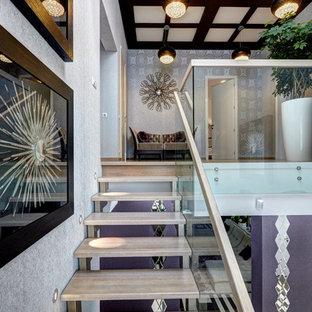 На фото: лестницы в современном стиле с деревянными ступенями без подступенок