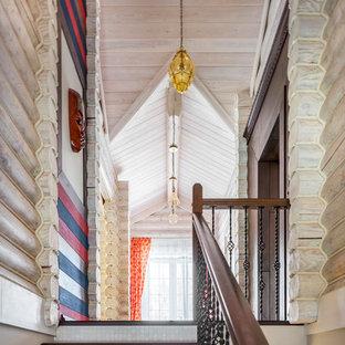 На фото: со средним бюджетом лестницы среднего размера в стиле рустика с деревянными ступенями, подступенками из плитки и перилами из смешанных материалов
