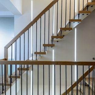 Design ideas for a medium sized scandinavian wood straight staircase in Novosibirsk with wood risers.
