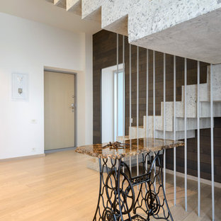 Foto de escalera en U, contemporánea, con escalones de hormigón y contrahuellas de hormigón