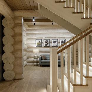 На фото: п-образная лестница среднего размера в стиле рустика с деревянными ступенями, деревянными подступенками, деревянными перилами и деревянными стенами с