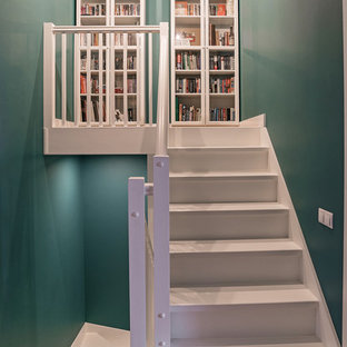 Inspiration for a scandinavian painted straight staircase remodel in Yekaterinburg with painted risers