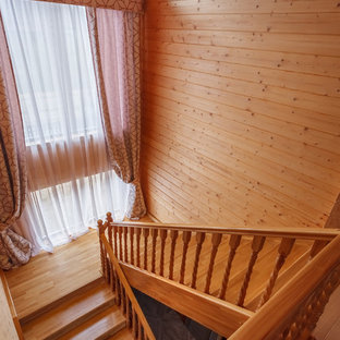 Staircase - mid-sized painted u-shaped wood railing staircase idea in Moscow with painted risers