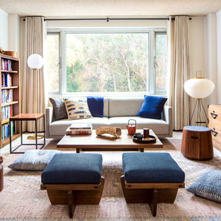 Small trendy enclosed carpeted and beige floor living room library photo in San Francisco with no tv and white walls