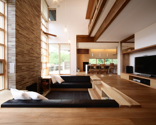 Example Of A Minimalist Medium Tone Wood Floor Living Room Design In Kyoto With White Walls