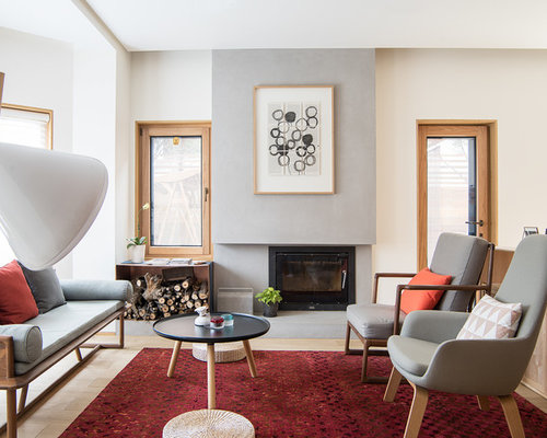 example of a midcentury formal living room design in san francisco with white walls light