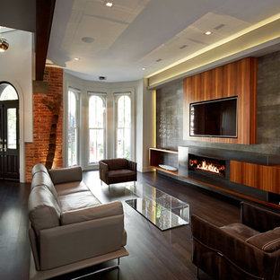 Trendy open concept dark wood floor living room photo in DC Metro with white walls, a ribbon fireplace, a metal fireplace and a wall-mounted tv