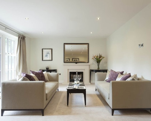 Example Of A Transitional Formal Carpeted Living Room Design In London With White Walls And