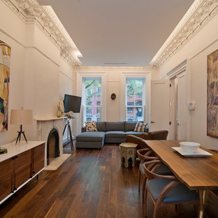 Example of a small transitional dark wood floor living room design in New York with a standard fireplace