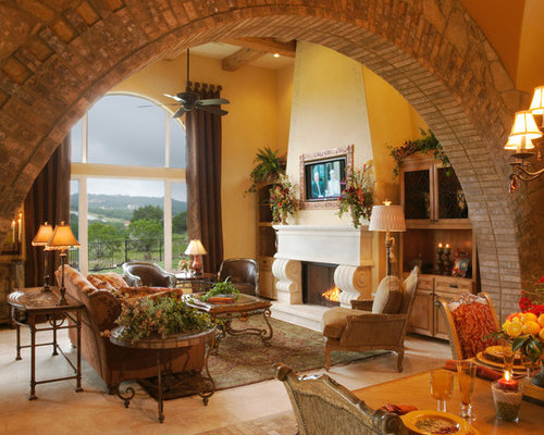 Example Of A Large Tuscan Living Room Design In Austin With Standard Fireplace