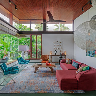 Ejemplo de salón para visitas cerrado, de estilo zen, sin televisor, con paredes blancas y suelo turquesa