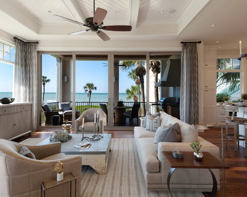 Inspiration For A Tropical Open Concept Living Room Remodel In Miami With  White Walls