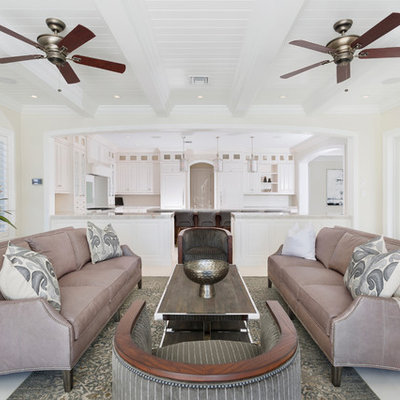 Inspiration for a tropical formal and open concept gray floor and ceramic tile living room remodel in Other with beige walls and no tv
