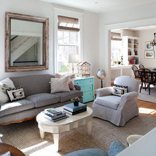 Example of a mid-sized cottage chic medium tone wood floor living room design in DC Metro