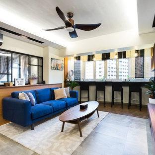 Esempio di un soggiorno minimal con angolo bar, pareti grigie, TV a parete e pavimento grigio