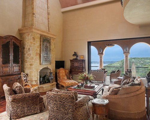 Inspiration For A Mediterranean Living Room Remodel In Austin With A  Standard Fireplace And A Stone