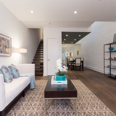 Trendy open concept living room photo in DC Metro with white walls