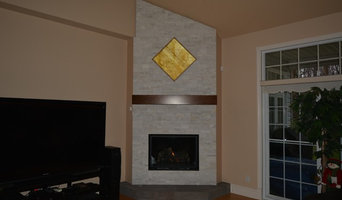 "14'-00"" Stone fireplace surround with a back-lit onyx feature"