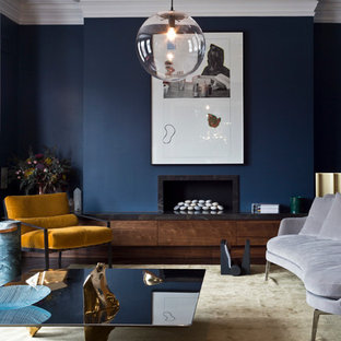 Inspiration for a contemporary formal living room in London with blue walls and a ribbon fireplace.