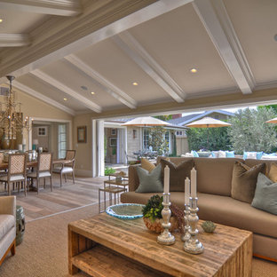 Beach style open concept living room photo in Los Angeles with beige walls