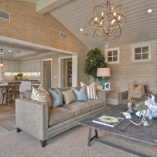 Example of a coastal open concept living room design in Los Angeles with beige walls