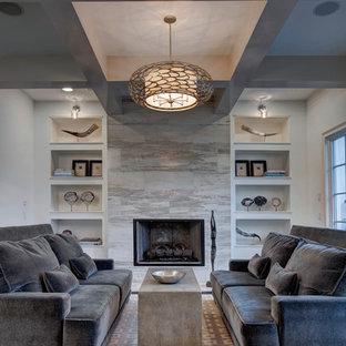 Esempio di un soggiorno chic con sala formale, pareti bianche, camino classico, cornice del camino in pietra, nessuna TV e parquet scuro