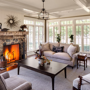 Inspiration for a cottage living room remodel in Milwaukee with white walls, a standard fireplace, a stone fireplace and no tv