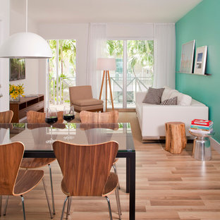 Example of a trendy open concept medium tone wood floor living room design in Miami with blue walls