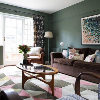 Living room - transitional living room idea in Kent with green walls