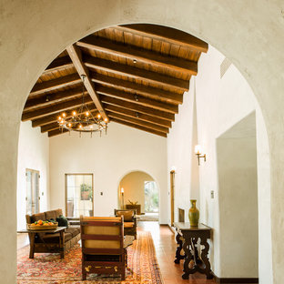 Huge southwest formal and enclosed concrete floor and red floor living room photo in Phoenix with white walls, a standard fireplace, a plaster fireplace and no tv