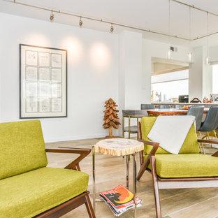 Foto di un soggiorno moderno di medie dimensioni e aperto con pareti bianche, pavimento in gres porcellanato, nessun camino e pavimento grigio