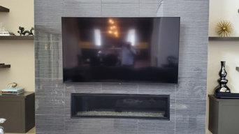 "2 82"" Samsung TVs on Tile Fireplaces"
