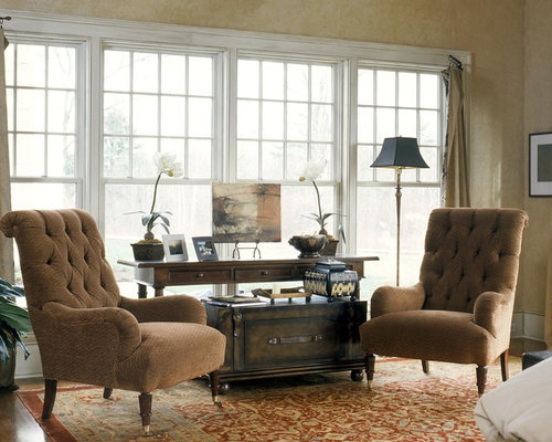 Example of a classic living room design in Boston with beige walls