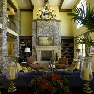 Living room - mediterranean living room idea in Denver with yellow walls and a standard fireplace