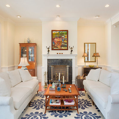 Mid-sized island style formal and open concept medium tone wood floor and brown floor living room photo in Other with beige walls, a standard fireplace, a stone fireplace and no tv