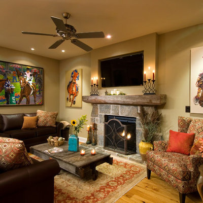 Living room - cottage medium tone wood floor living room idea in New York with beige walls, a standard fireplace, a stone fireplace and a wall-mounted tv