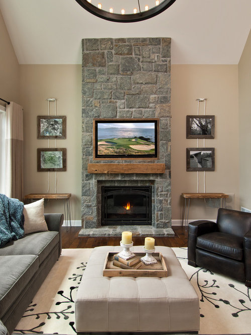 Traditional enclosed living room idea in Boston with beige walls, a  standard fireplace and a