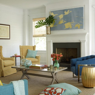 Beach style medium tone wood floor living room photo in Charleston with white walls, a standard fireplace and a stone fireplace