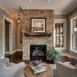 Elegant enclosed dark wood floor and brown floor living room photo in Minneapolis with beige walls, a standard fireplace and a stone fireplace