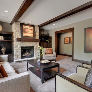 Example of a classic carpeted living room design in Minneapolis with beige walls, a standard fireplace and a stone fireplace