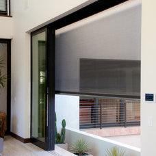 Contemporary Living Room by Phantom Screens