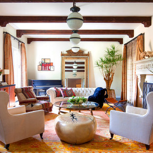 Inspiration for a mediterranean dark wood floor living room remodel in Los Angeles with beige walls and a standard fireplace