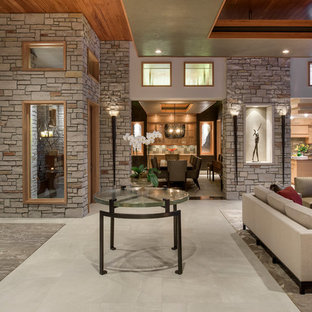 Example of a huge trendy open concept porcelain floor living room design in Minneapolis with a ribbon fireplace, a stone fireplace, a wall-mounted tv and beige walls