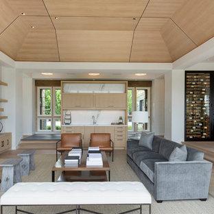 Ejemplo de salón para visitas abierto, minimalista, extra grande, con paredes blancas, suelo de madera clara, chimenea tradicional y marco de chimenea de piedra
