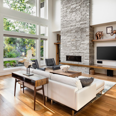 Living room - huge contemporary formal and open concept light wood floor living room idea in Portland with white walls, a stone fireplace, a wall-mounted tv and a ribbon fireplace