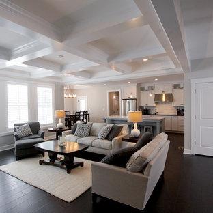 Esempio di un grande soggiorno classico aperto con pareti grigie, parquet scuro, camino classico, TV a parete, sala formale, cornice del camino in legno e pavimento marrone