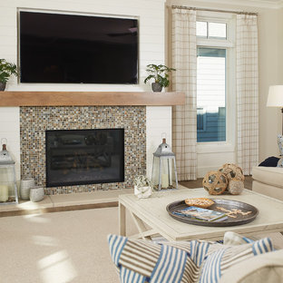 Inspiration for a coastal open concept medium tone wood floor living room remodel in Grand Rapids with beige walls, a standard fireplace, a tile fireplace and a wall-mounted tv